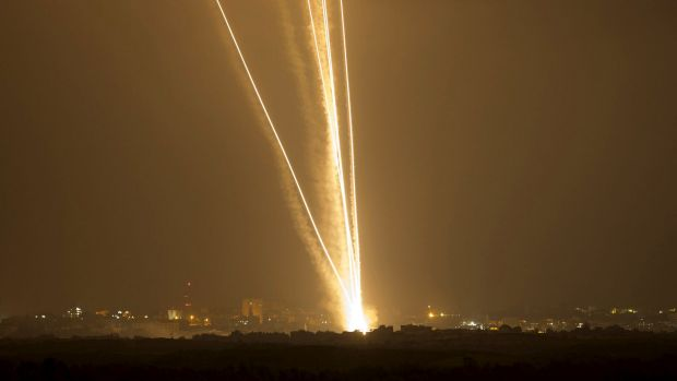 Light streaks and smoke trails from  rockets launched from Gaza towards Israel on July 23, 2014.