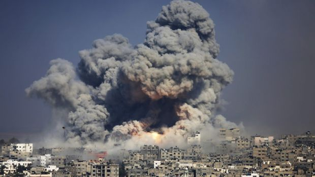 Smoke and fire from the explosion of an Israeli strike rise over Gaza City on July 29, 2014.