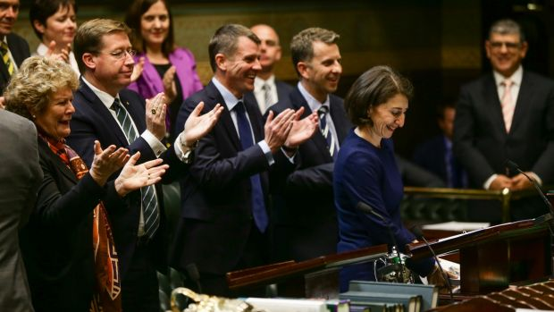 Mike Baird and the front bench applaud at the conclusion of Treasurer Gladys Berejiklian's budget speech.