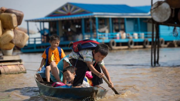 Children paddle to school.