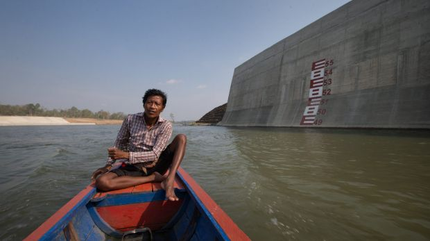 Ota Khami drives his boat where his home used to be.