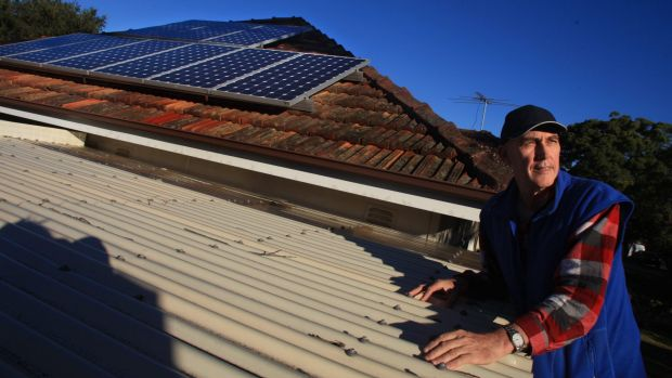 Peter Thompson with solar panels on the roof of his home in Miranda. There is no planned change to the popular roof-top ...