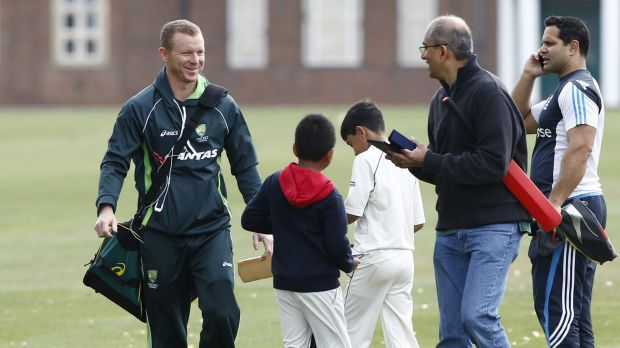 Fans greet Chris Rogers at a practice session at Watford, north-west of London.