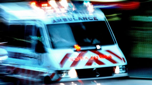 The man has been rushed to hospital after being knocked unconscious.