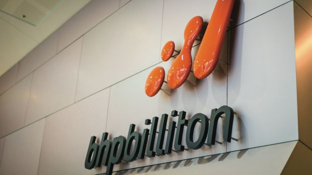 BHP Billiton's iron ore output was hampered by the Samarco dam disaster and a train derailment in the Pilbara.