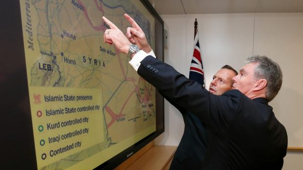 ASIO director-general Duncan Lewis briefs then prime minister Tony Abbott on Islamic State earlier this year.