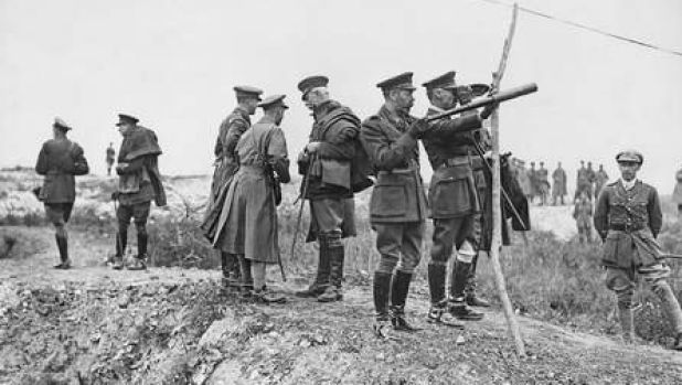King George V, holding telescope, watching the battle of Pozieres from captured ground.