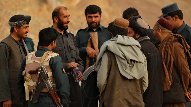The late Matiullah Khan (third from left) with his men on the Tarin Kowt to Kandahar highway in January 2013