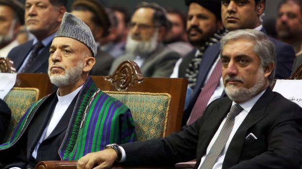 The decision of Afghan President Hamid Karzai, left, to hand over power at the end of his term threw warlords under his ...