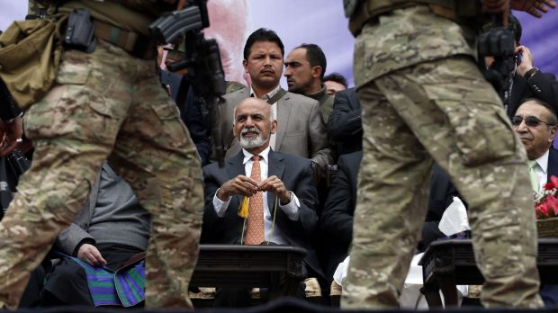 New Afghan President Ashraf Ghani, centre in orange tie, may see men like Matiullah Khan as a burden when it comes to ...
