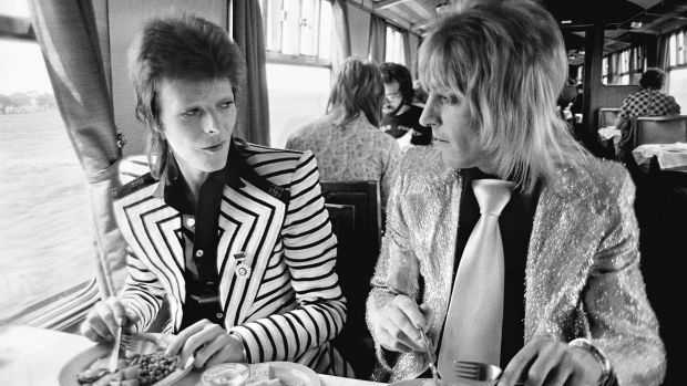 May 14, 1973, Bowie with his intrepid guitarist Mick Ronson (aka Ronno) having a British Rail lunch on the train to ...