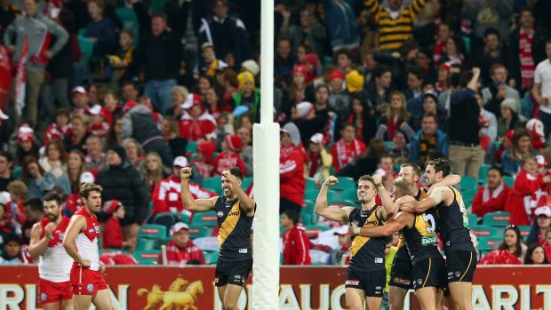 Big win: Jack Riewoldt of the Tigers and teammates celebrate winning at the SCG.