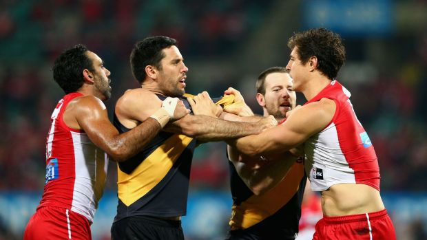 Tensions rise: Troy Chaplin of the Tigers and Kurt Tippett of the Swans exchange words.