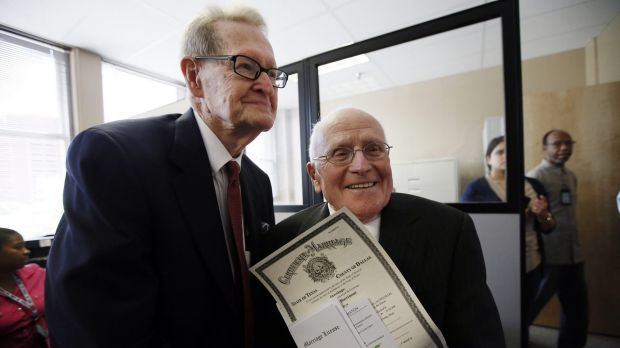 Jack Evans, 84, left, and George Harris, 82, right, show their marriage licence after being the first couple to receive ...