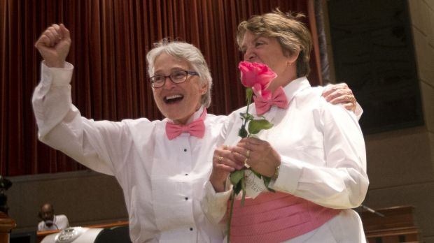 Barbra Schwartz, left, Julia Troxler celebrate after being married in a mass wedding at the Fulton County Government ...