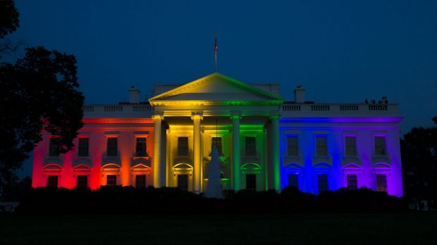 The White House is illuminated in celebration after the Supreme Court ruled that the Constitution guarantees a right to ...
