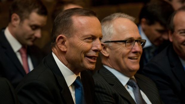 Malcolm Turnbull, right, pictured with Prime Minister Tony Abbott, has declined an invitation to appear on Monday's ...
