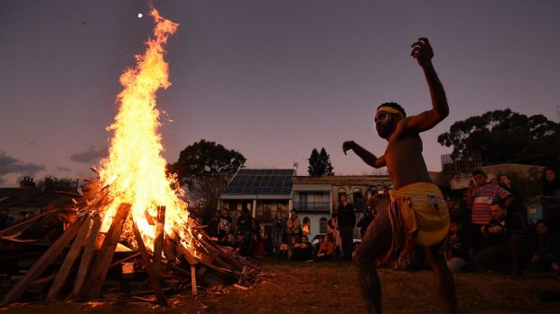 Steadman Sailor, 28, from Redfern dances during corroboree at The Block in Redfern, after the protest.