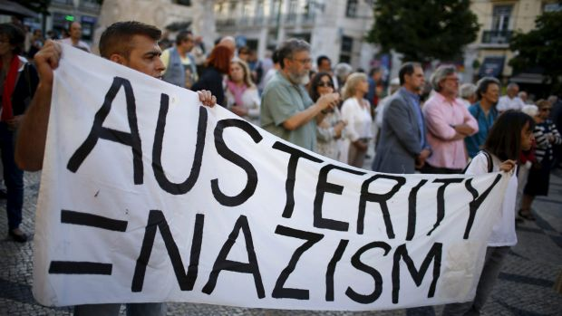 Demonstrators in Lisbon, Portugal, march in favour of the Greek government.