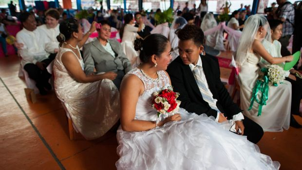 "Filipino gay couples exchange ""Rite of Holy Union"" vows during a mass ""wedding rites"" in June in Manila. A small ..."