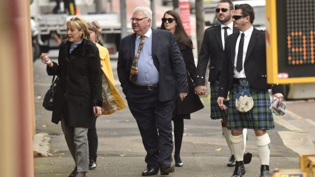 Paul Rossington's brothers wear the family tartan as a tribute to their brother while accompanying their parents and ...