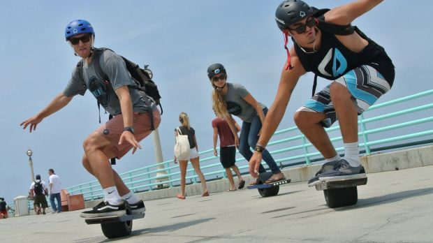 High-tech commuters glide past the road rules.