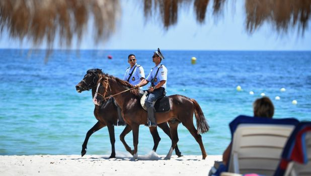 Security patrol Marhaba beach on Monday at the scene where 38 people were killed in a terrorist attack last week.