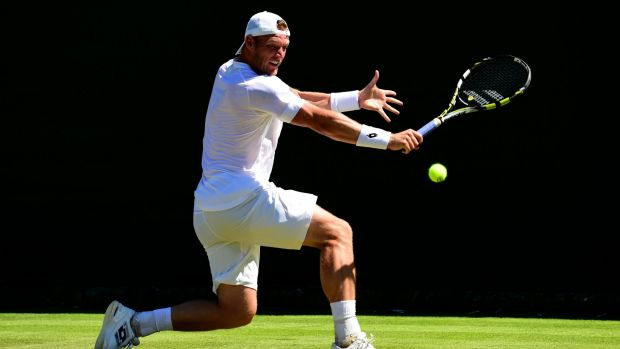 Sam Groth plays a backhand against Jack Sock of the United States.