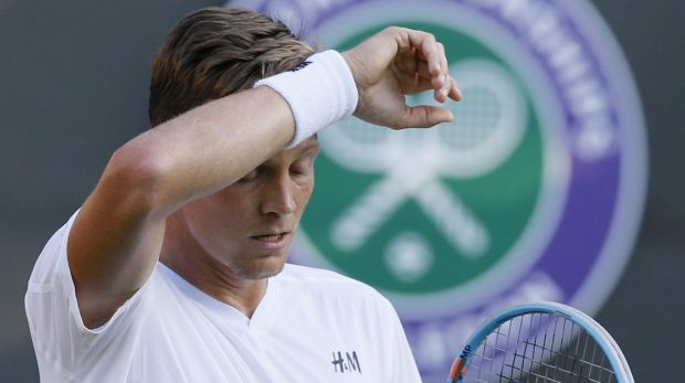 Tomas Berdych of the Czech Republic wipes his face during the singles first round match at Wimbledon.
