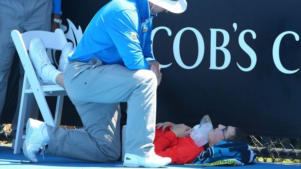 Flashback: A ballboy faints in the heat, as Melbourne heads towards 43 degrees celsius during day two of the 2014 ...