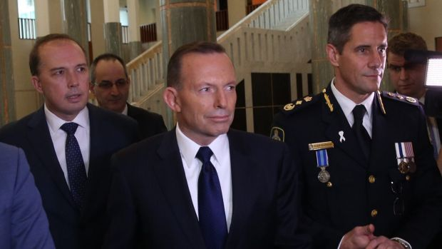 Immigration Minister Peter Dutton and Prime Minister Tony Abbott attend the swearing in ceremony of the inaugural Border ...