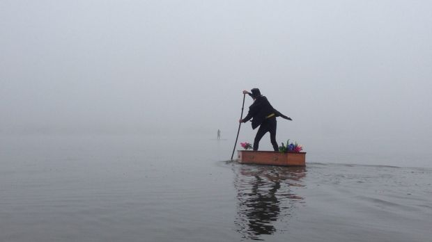 'The Lost Undertaker' turned heads when he rowed his stand-up-paddleboard coffin on Lake Burley Griffin.