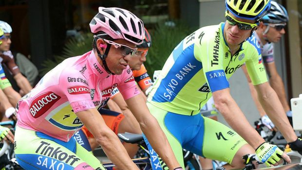 Battling: Michael Rogers (right) talks to Alberto Contador.