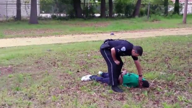 North Charleston police officer Michael Slager is seen standing over 50-year-old Walter Scott after allegedly shooting ...