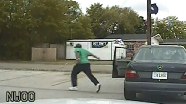 An image taken from a police dash camera shows Walter Scott running from his vehicle just before he was shot and killed ...