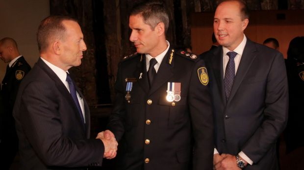 Prime Minister Tony Abbott at the swearing in ceremony of the inaugural Border Force Commissioner Roman Quaedvlieg with ...