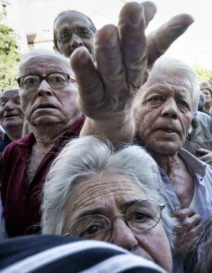 Pensioners queue outside an Athens bank on Wednesday when they were allowed to withdraw a small part of their benefits.
