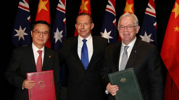 Andrew Robb with Dr Gao Hucheng, China's Minister of Commerce, and former prime minister Tony Abbott.