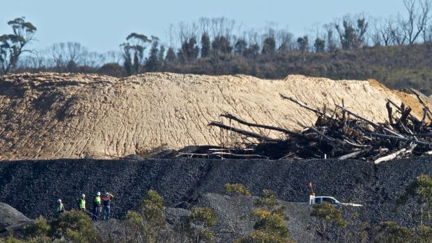 EPA and mine staff inspect the damage.