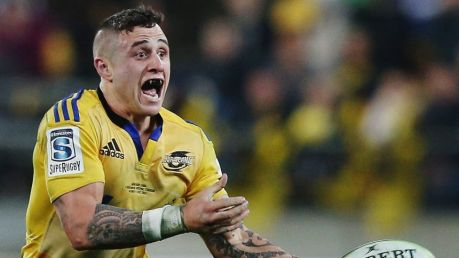 WELLINGTON, NEW ZEALAND - JULY 04: TJ Perenara of the Hurricanes passes the ball out during the Super Rugby Final match ...