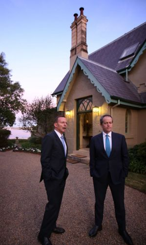 Prime Minister Tony Abbott and Opposition Leader Bill Shorten greet guests at Kirribilli House.