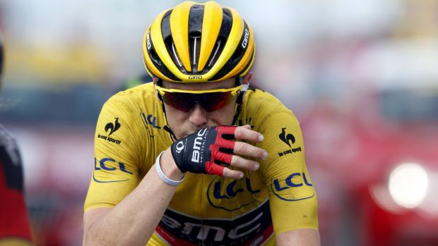 Rohan Dennis crosses the line after losing the yellow jersey after stage two on Sunday.