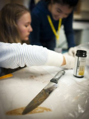 A bloodied knife holds clues for junior investigators at the Forensic Science Camp.