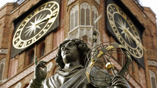 Nicholas Copernicus' statue stands proud in front of the Old Town Hall in his home town of Torun, Poland.