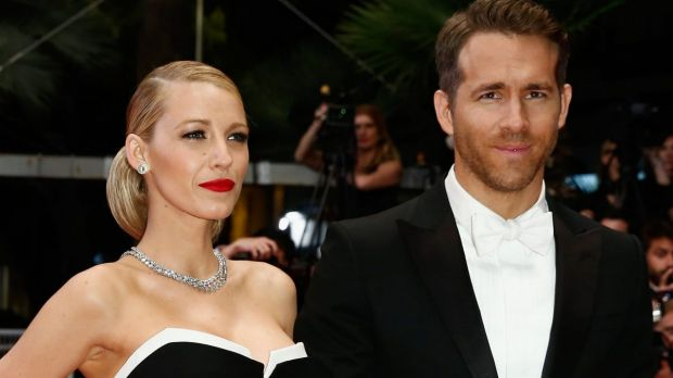 Shaking it out: Blake Lively with husband Ryan Reynolds .