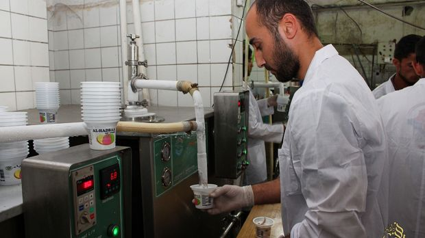 A television channel run by Islamic State  shows ice cream being manufactured in the Iraqi city of Mosul, now held by IS ...