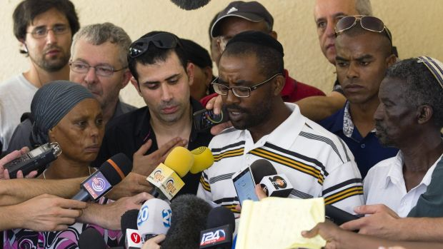 Avera Mengistu's brother Ilan speaks to the media outside the family home in the southern city of Ashkelon.