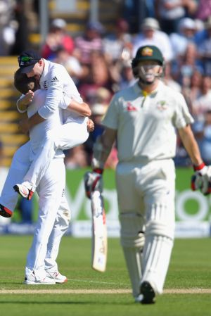 England's Adam Lyth congratulates his teammate Mark Wood for  denying Australia Chris Rogers (right) a century by ...