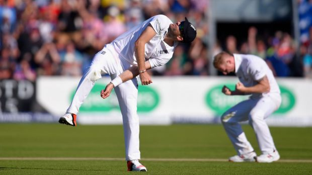England's Jimmy Anderson throws the ball in the air in celebration after taking a catch, off the bowling of Ben Stokes ...