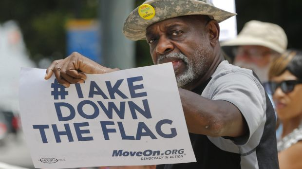A protester against the Confederate flag, Theron Foster, of Columbia, gives a clear message outside the South Carolina ...